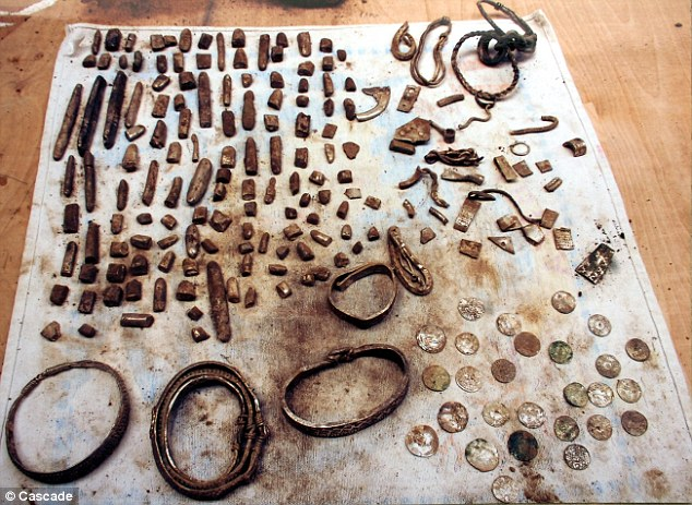 Treasure trove: Darren Webster uncovered a 1,000-year-old casket containing 200 pieces of silver jewellery, coins, hacksilver and ingots while using his metal detector in Cumbria.