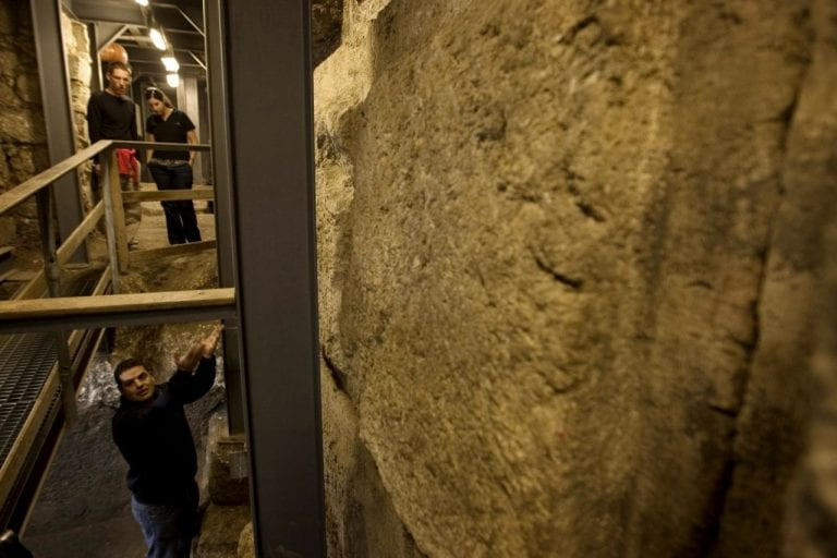 Israel's Antiquities Authority archeologist Eli Shukron, below, stands in the Mikve area at the base of the Western Wall where an archaeological dig has uncovered ancient coins which may help date the Western Wall, the holiest site where Jews can pray, in Jerusalem's Old City, Wednesday, Nov. 23, 2011. Newly found coins underneath the Western Wall are identified as stamped by a Roman proconsul 20-years after the death of Herod, a Jewish ruler who died in 4 B.C., and could change the accepted belief about the construction of one of the world's most sacred sites two millennia ago, Israeli archaeologists said Wednesday. (AP Photo/Sebastian Scheiner) Israel's Antiquities Authority archeologist Eli Shukron, below, stands in the Mikve area at the base of the Western Wall where an archaeological dig has uncovered ancient coins which may help date the Western Wall, the holiest site where Jews can pray, in Jerusalem's Old City, Wednesday, Nov. 23, 2011. Newly found coins underneath the Western Wall are identified as stamped by a Roman proconsul 20-years after the death of Herod, a Jewish ruler who died in 4 B.C., and could change the accepted belief about the construction of one of the world's most sacred sites two millennia ago, Israeli archaeologists said Wednesday. (AP Photo/Sebastian Scheiner)