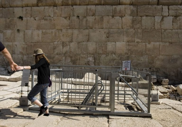 Visitors walk in the Davidson Center near the Western Wall, the holiest site where Jews can pray, in Jerusalem's Old City, Wednesday, Nov. 23, 2011. Newly found coins underneath the Western Wall are identified as stamped by a Roman proconsul 20-years after the death of Herod, a Jewish ruler who died in 4 B.C., and could change the accepted belief about the construction of one of the world's most sacred sites two millennia ago, Israeli archaeologists said Wednesday.(AP Photo/Sebastian Scheiner)
