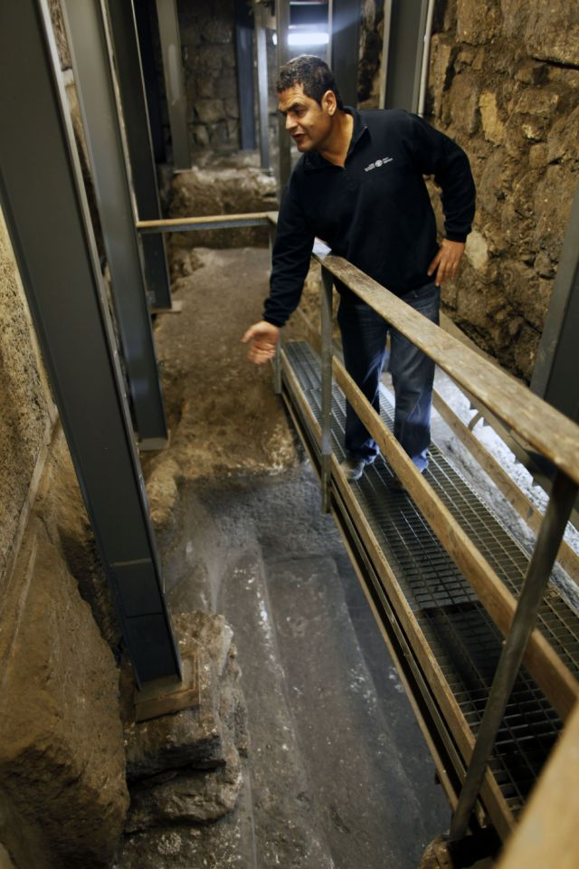 Israeli Archaeologist Eli Shukron of the Israel Antiquities Authority looks inside a ritual bath exposed beneath the Western Wall on November 23, 2011 in Jerusalem's Old City, Israel. Archaeologists in Jerusalem have uncovered two bronze coins - which according to Israel Antiquities Authority archaeologists were struck by the Roman procurator of Judea, Valerius Gratus, in the year 17/18 CE - inside an ancient Jewish ritual bath by the Wailing Wall in the Old City, challenging the assumption that all of the walls of the Second Jewish Temple were built by King Herod. (Photo by Lior Mizrahi/Getty Images) Israeli Archaeologists Rethink Herod's Role In Western Wall Construction