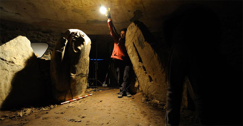 Not all the rock art they seek out can be reached easily. And photographing it in situ can require lighting. Note the measuring stick to give the image scale.