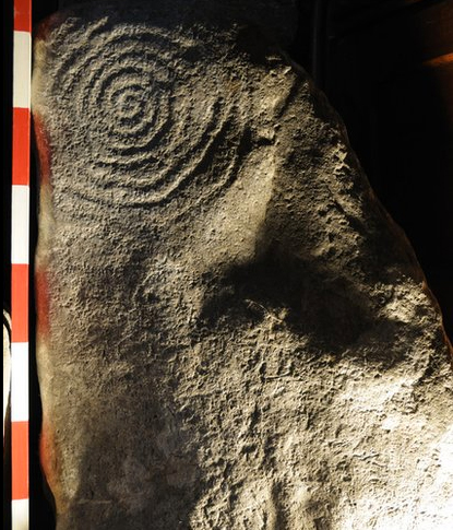 Ancient but sophisticated farming societies worked hard at their art. The Llanbedr spiral stone, a clockwise 10-ringed spiral, was pecked away by hand. This pagan symbol is found on a stone first recorded near Dyffryn Ardudwy, Gwynedd, in the 19th Century. It now stands behind the font of a church.