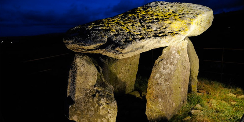 """Photographing in the dark is sometimes the best way to highlight how much art is on an ancient stone monument. Up to 110 cupmarks are found on the capstone of Bachwen, a burial-ritual monument in Gwynedd. The jury is still out on whether all these are original or some are later Bronze Age """"graffiti""""."""