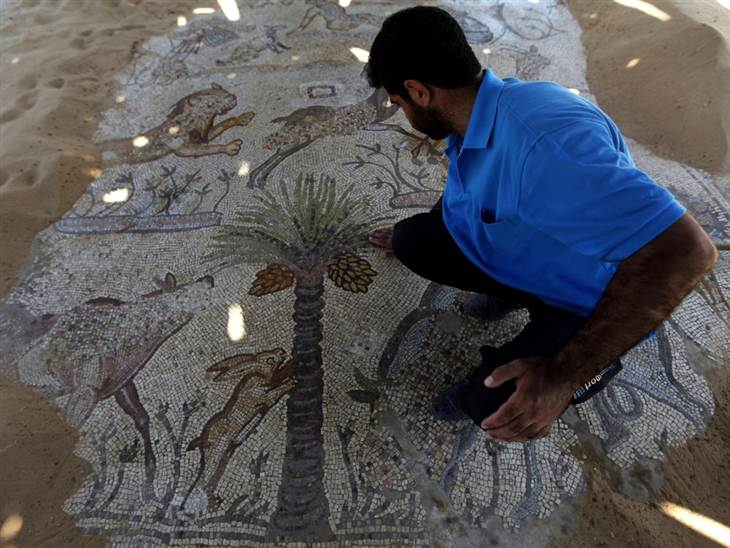 A visitor looks at a mosaic in the Gaza Strip's Jabaliya refugee camp - a reminder from a time in late antiquity when Christianity was the dominant faith in Gaza.
