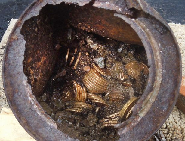 "One of the six decaying metal canisters filled with 1800s-era U.S. gold coins unearthed in California by two people who want to remain anonymous. The value of the ""Saddle Ridge Hoard"" treasure trove is estimated at $10 million or more. Photo: Associated Press"