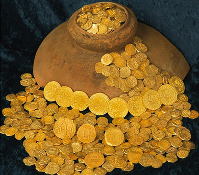 Royal coins, dozens of other prized pieces flow out and around an Olive Jar that was pulled from the 1715 Fleet.