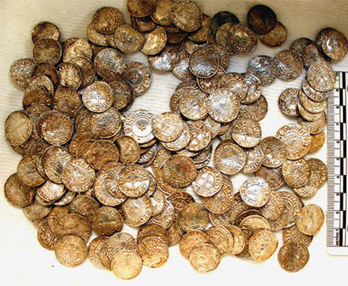 The condition of the coins amazes the finder and researchers who are working clean them. A small portion of the 1,000 that had been cleaned as of Jan. 8 is on display in this image.