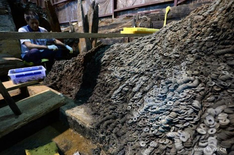 Featured image: Archaeologists found 10 tons of bronze coins in and around the tomb of a dethroned Chinese emperor of the first century BC. (Xinhua news photo)