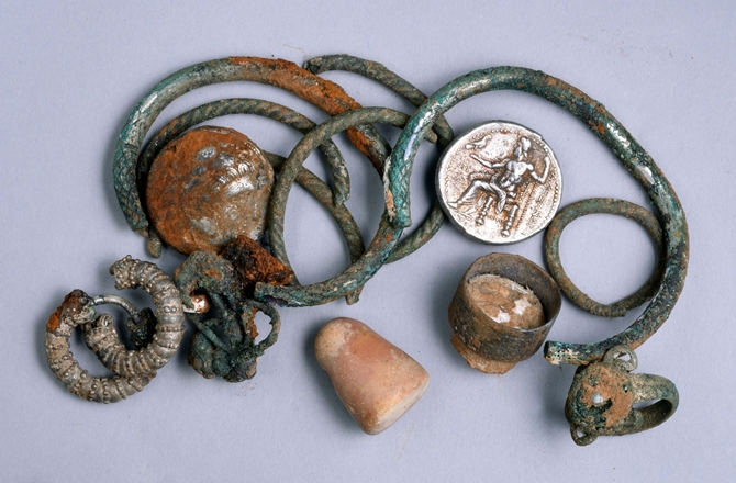 Included in the 2,300-year-old cache were two coins of Alexander of Macedon, three rings, four bracelets, two decorated earrings, three other earrings and a small stone weight. CLARA AMIT/ THE ISRAEL ANTIQUITIES AUTHORITY