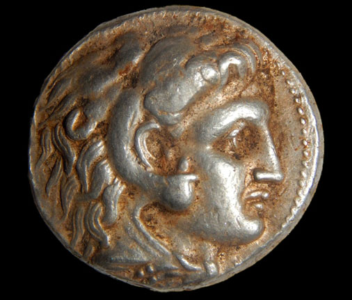 Stashed inside a niche, one of the spelunkers first spotted two ancient silver coins. On one side of the coins was an image of Alexander the Great, while the other side portrayed Zeus sitting on his throne. The archaeologists believe the coins had been minted in the late fourth century BC at beginning of the Hellenistic Period during the reign of Alexander the Great. PHOTOS: Excavating a Celtic Prince's Tomb. SHMUEL MAGAL/ISRAEL ANTIQUITIES AUTHORITY