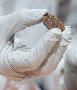 A copper medal coin depicting George Washington found in the time capsule. (Brian Synder/Reuters)