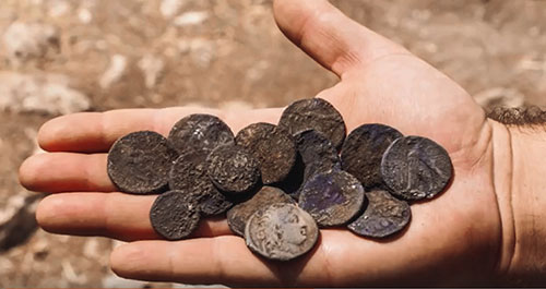 A small hoard of 16 silver half-shekel and shekel coins of the city of Tyre was found in Israel in April. Image courtesy of the Israel Antiquities Authority.