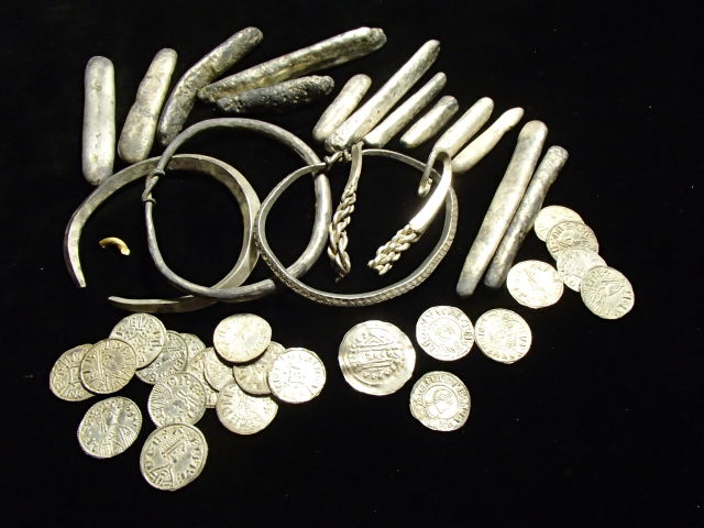 Part of the Viking hoard found in Watlington, including coins, ingots, and arm bands. Image courtesy of British Museum