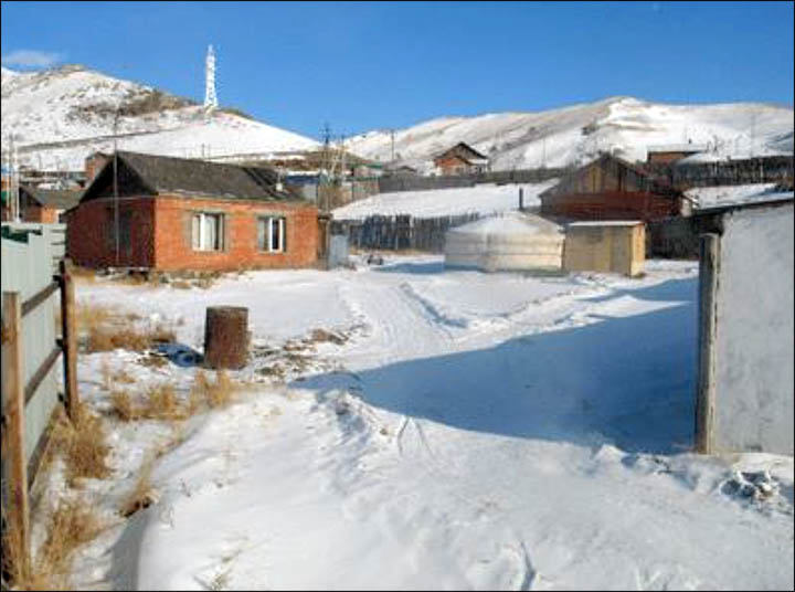 The 'meditating monk' and the house in Mongolia where it was hidden. Pictures: Morning Newspaper