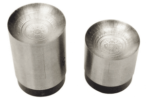 Concave hammer and anvil dies were used in striking the 2015 Seven New Wonders of the World silver $7 coin for Niue, to impact a curved surface at the poles of the coin.