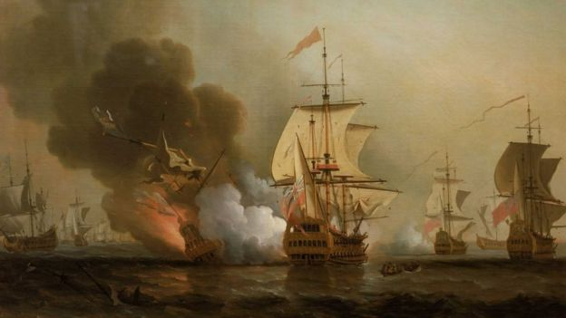 A Spanish galleon is seen here in an artist's depiction of trade on the high seas in the 16th century. Colombia says it's found a galleon from 1708 that is believed to hold billions of dollars' worth of treasure. (Image-bbc.com)