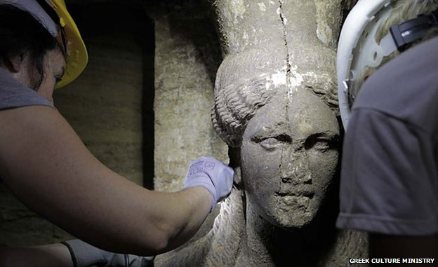 The western caryatid's face shown here is almost intact whereas the eastern caryatid's face is missing